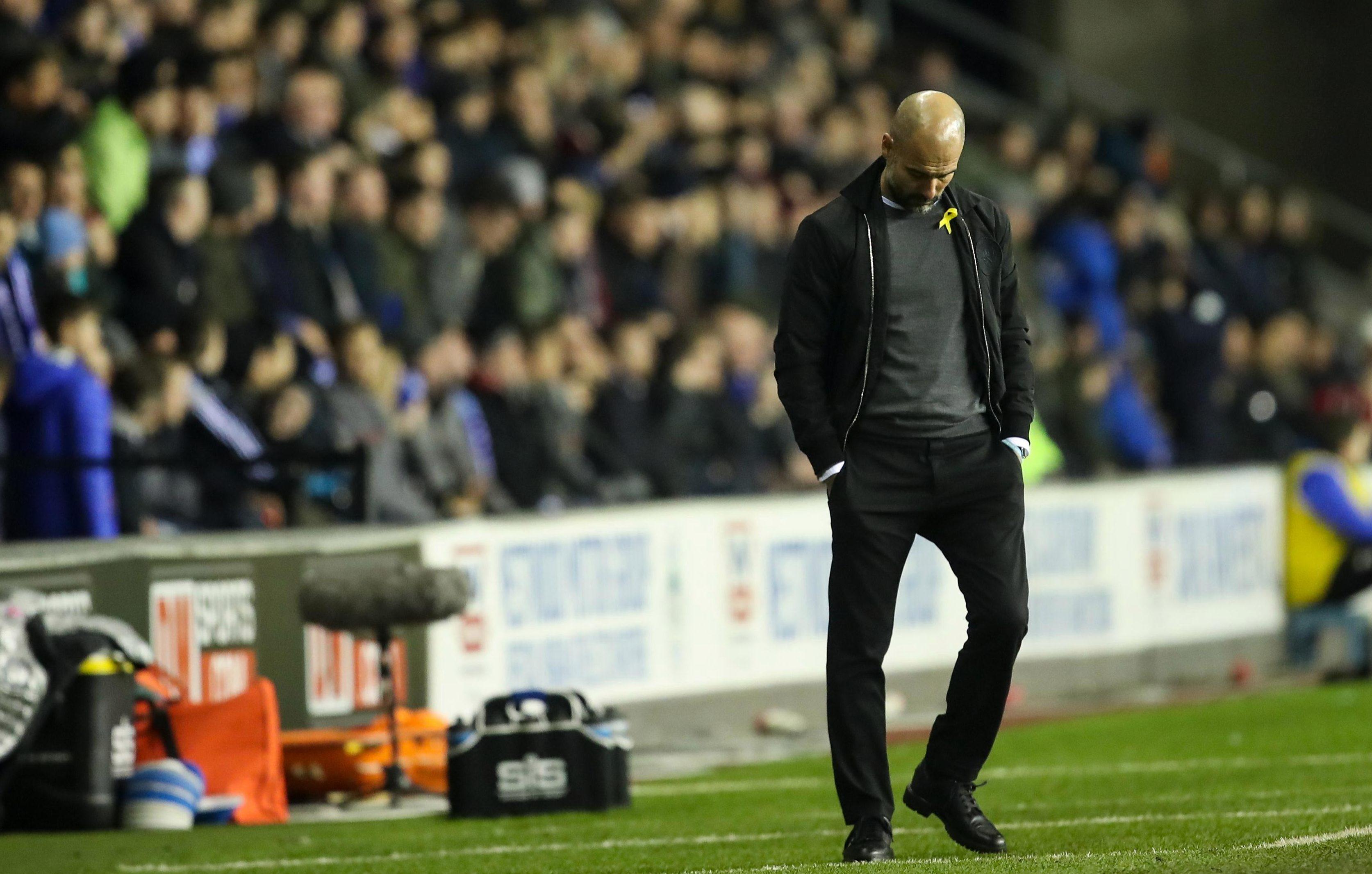 Guardiola hangs his head as the quadruple dream dies