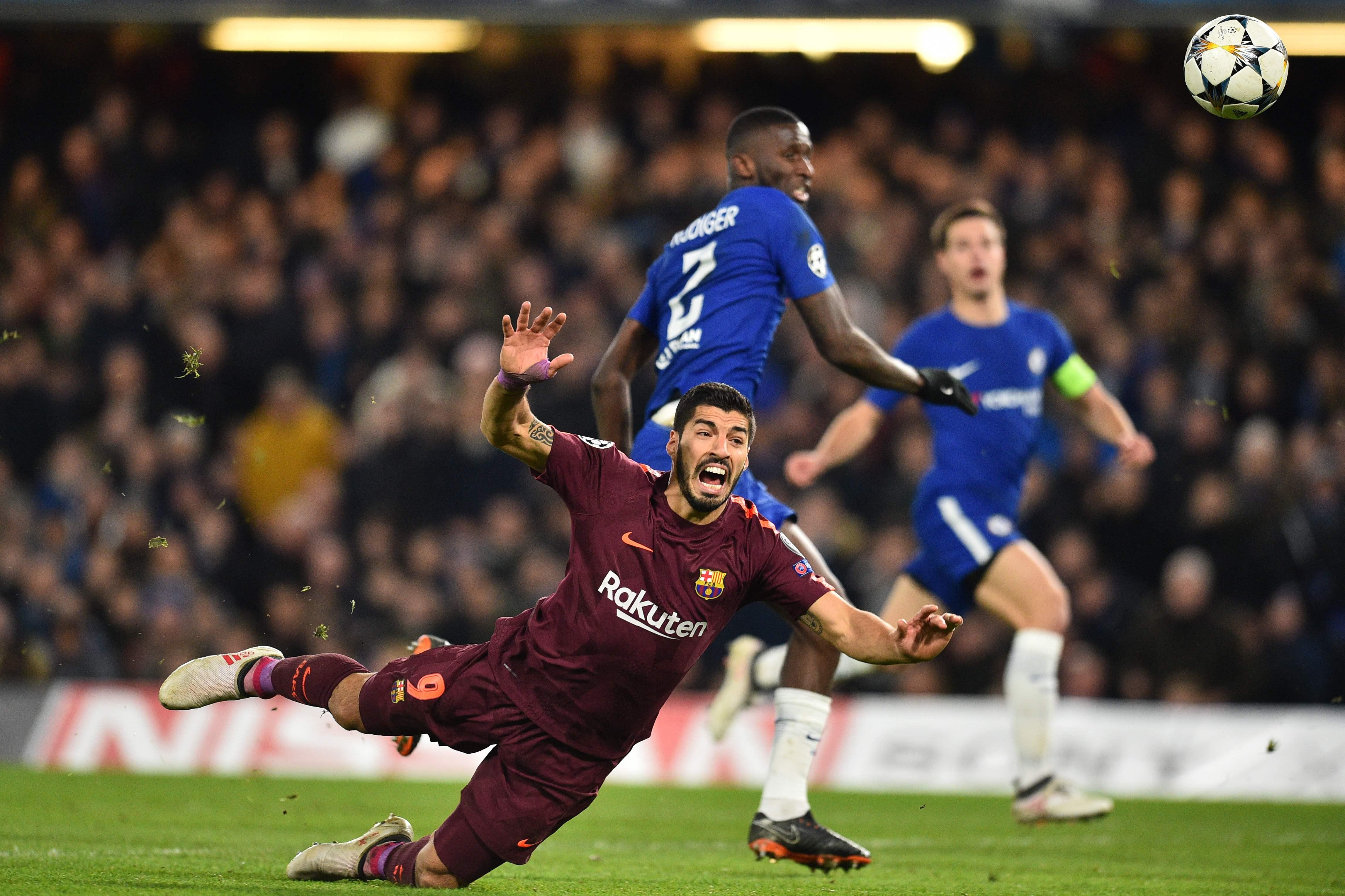 Rudiger challenges the striker from behind