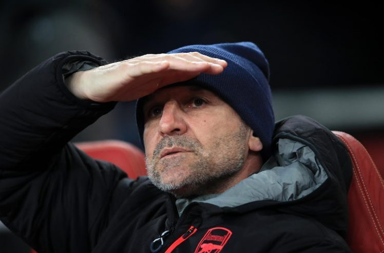 Steve Bould searching for Arsenal's defenders last night