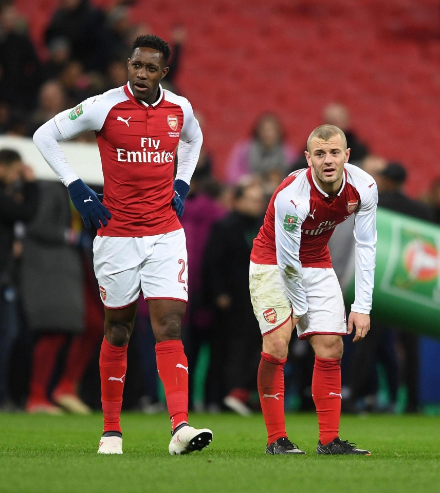 Danny Welbeck and Jack Wilshere look dejected during Carabao Cup final defeat
