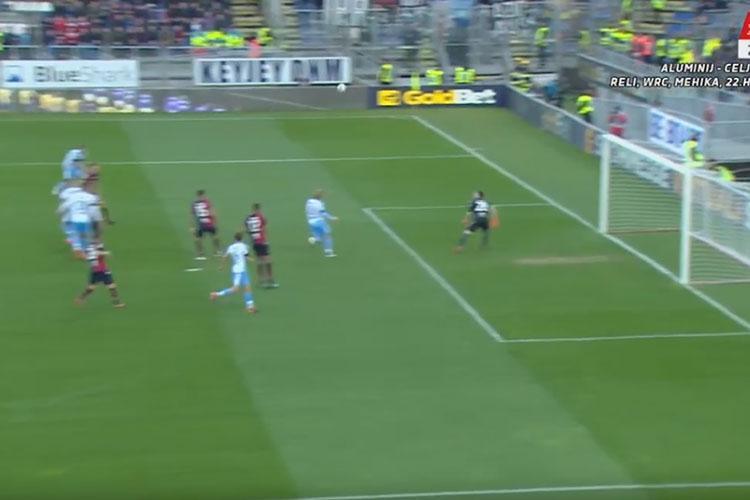 The goalkeeper – off his line – can only watch it loop over the top