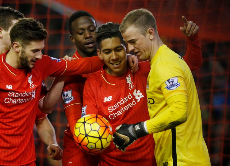 Firmino trying to explain to Joe Hart he supposed to stop the ball going in