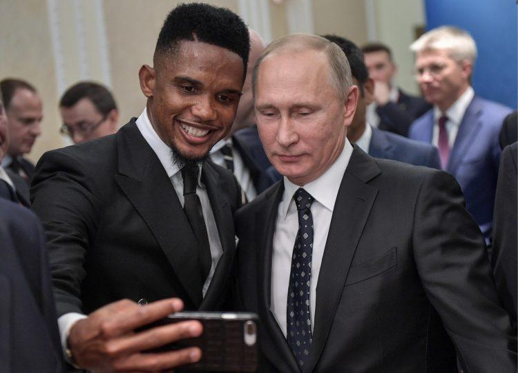 Samuel Eto'o taking a selfie with a fan
