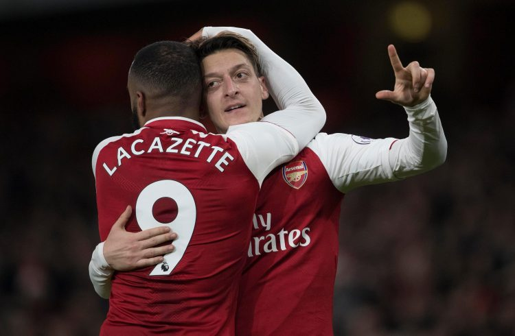Lacazette rubbing Ozil's head for luck