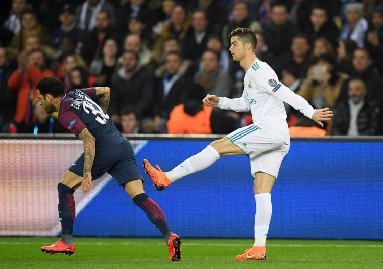 Ronaldo trying to kick Alves in frustration