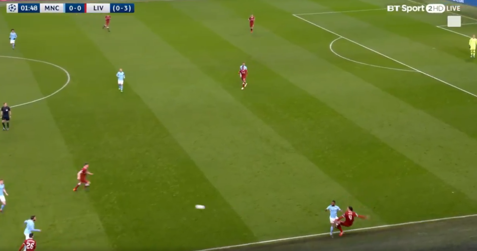 The defender doesn't have enough time to clear the ball cleanly and loses his balance on the touchline