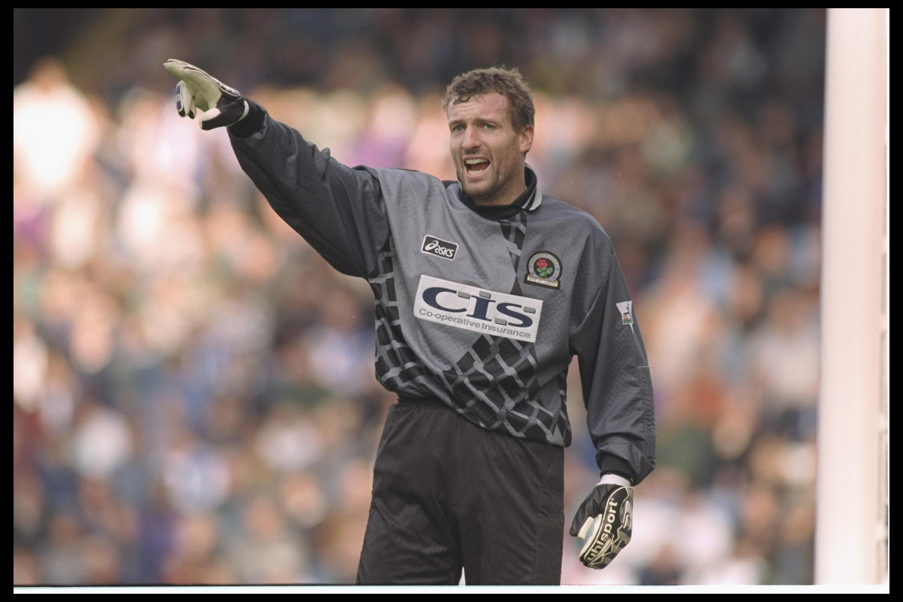 Everything about this picture of Tim Flowers feels vintage