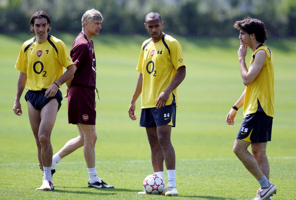 Cesc looks curiously at Robert Pires' shorts
