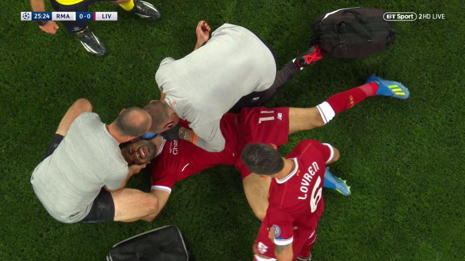 Liverpool's medical team quickly rushed on to help their distressed talisman
