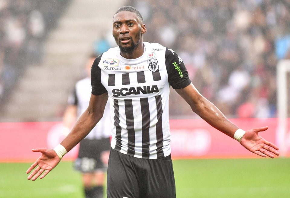 Fair play to Angers for ruining their kit with 16,000 different sponsors