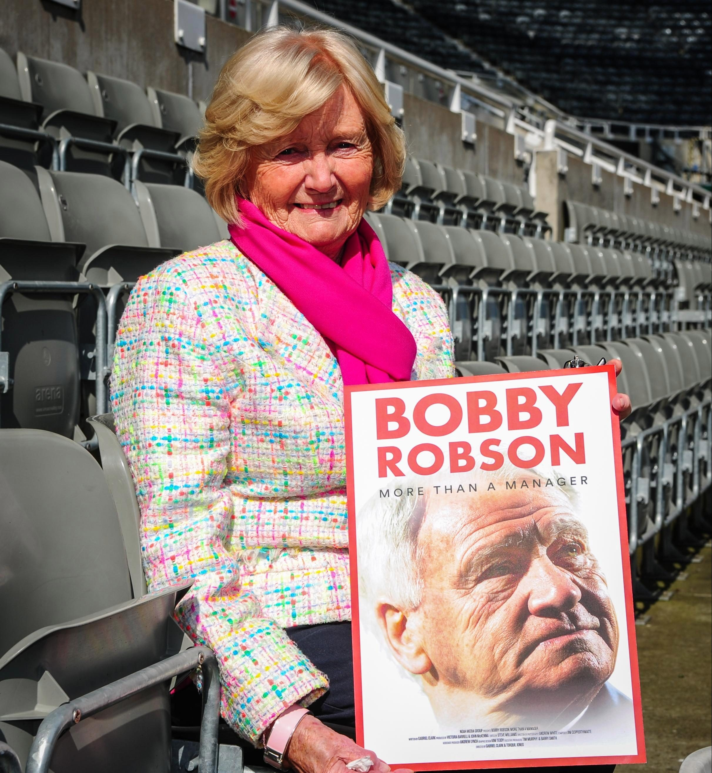 Sir Bobby Robson's wife, Elsie Robson, proudly shows off the film poster