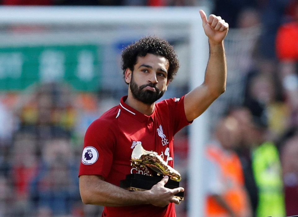 Showing off his golden boot