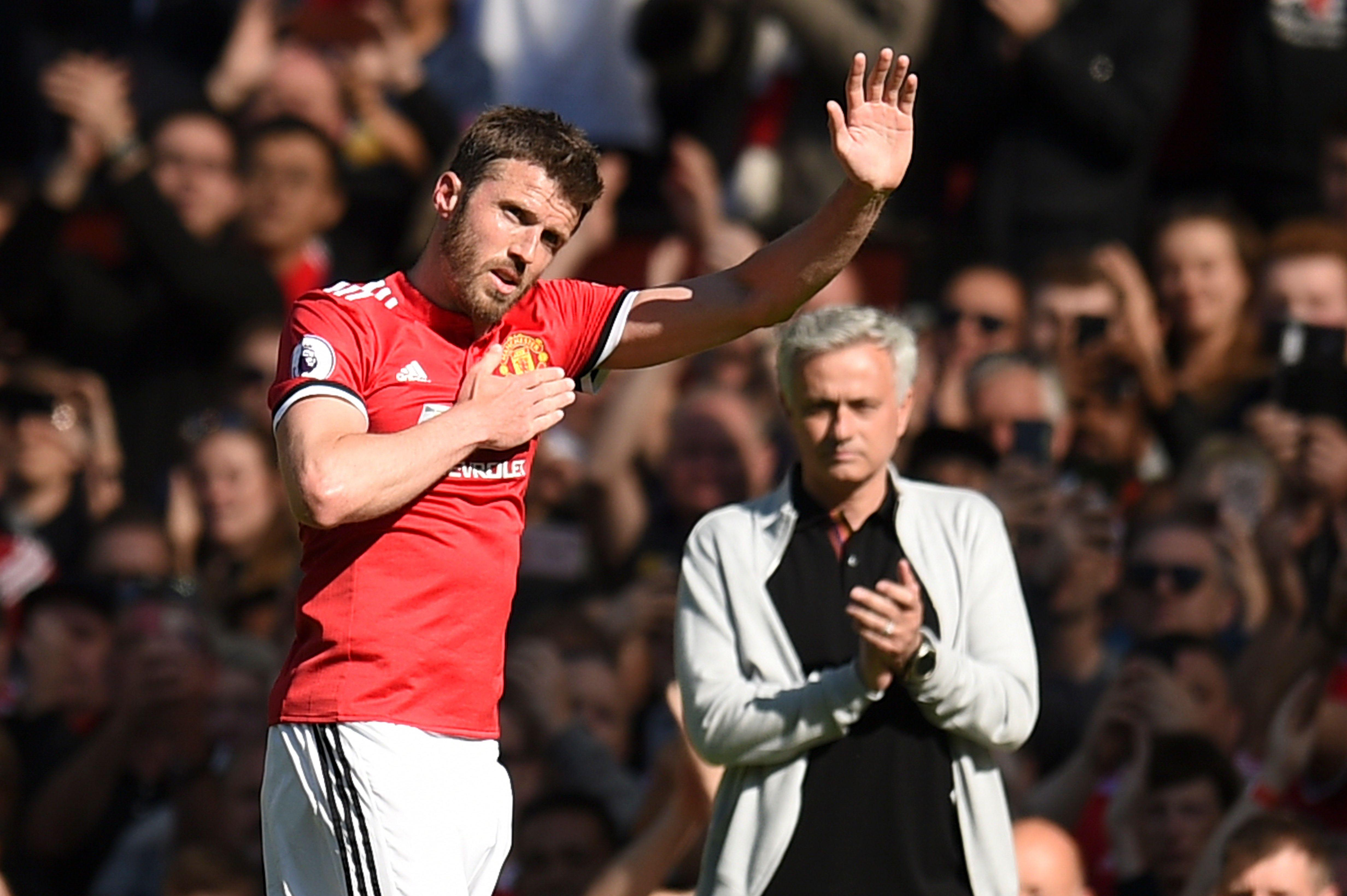 Carrick acknowledges the Old Trafford crowd one last time
