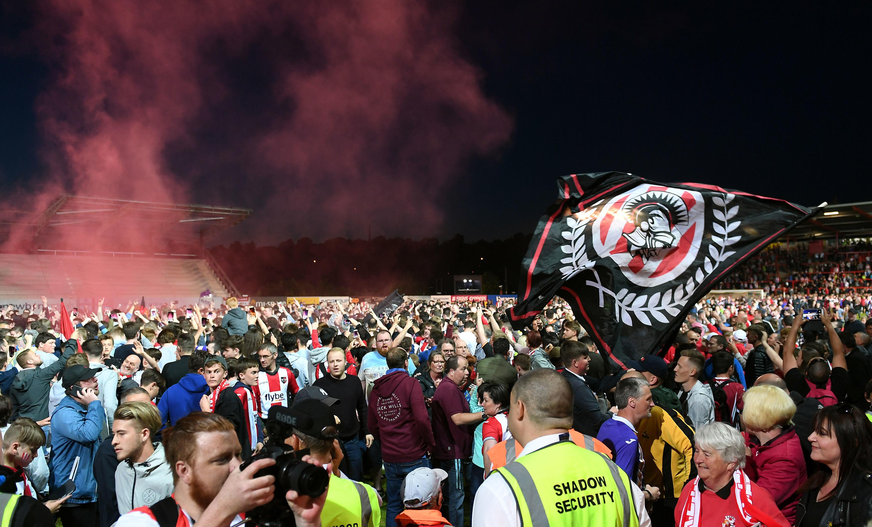 Thousands of Exeter fans ran onto the pitch