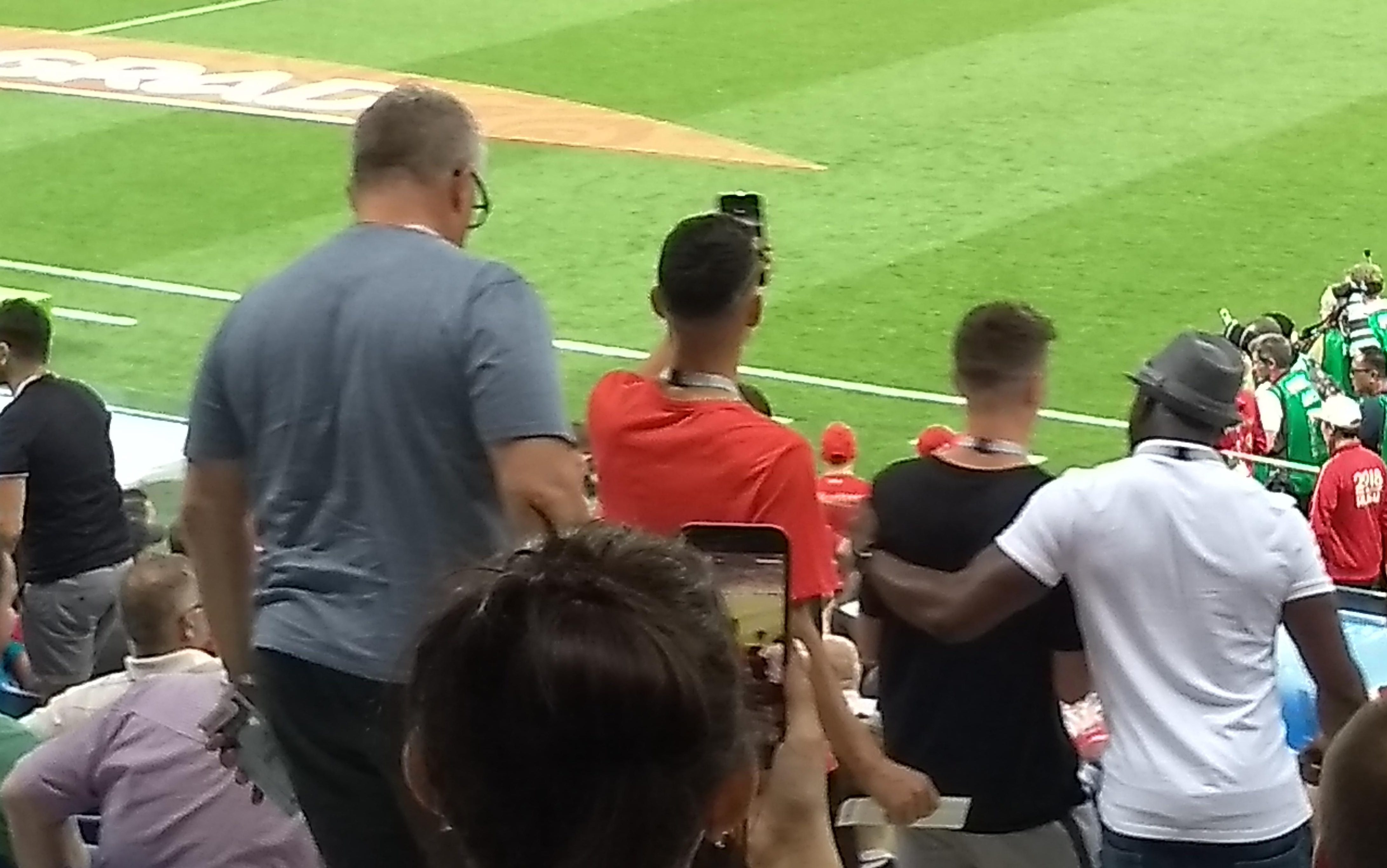 Yep, this is a picture of someone taking a picture of Phil Foden taking a picture of a football pitch