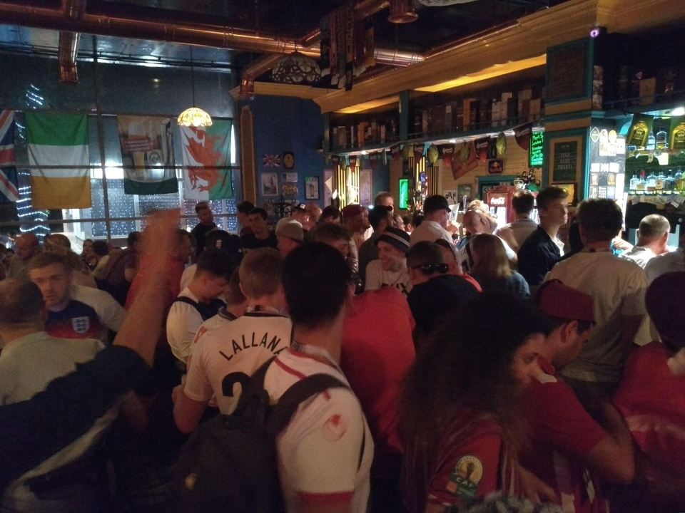 Even a seven deep queue for the bar doesn't dampen English spirits tonight