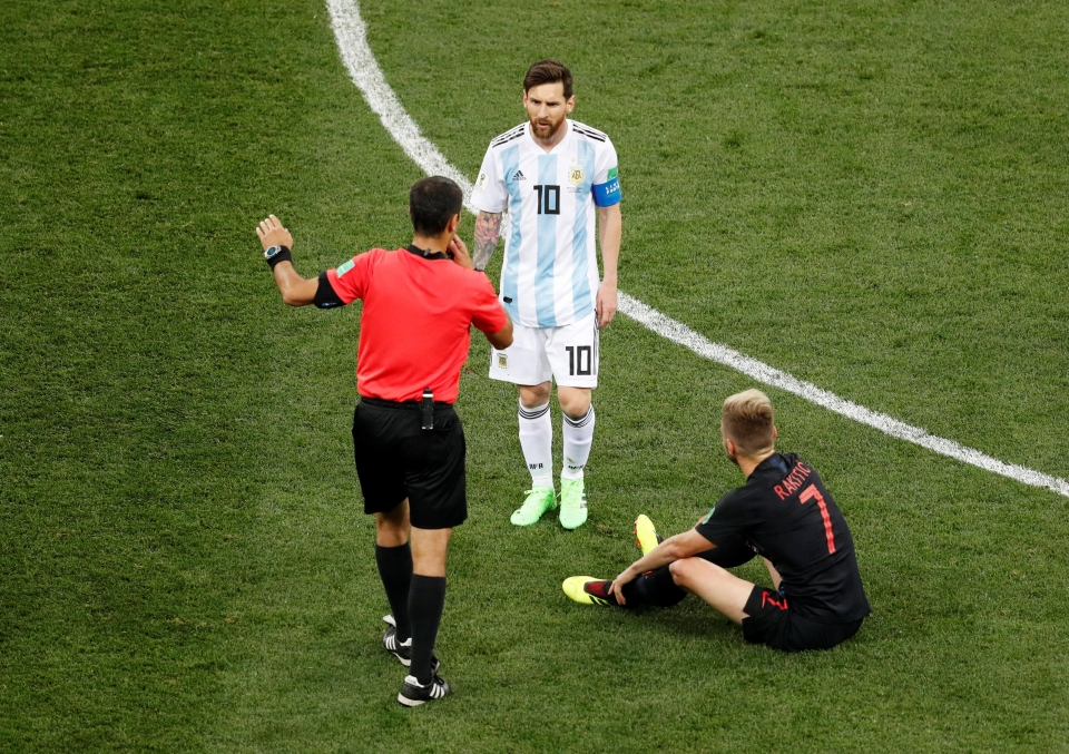 Messi got a stern telling off from the referee after committing a foul on his Barcelona team-mate Ivan Rakitic