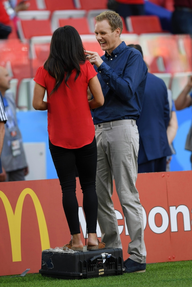 A suitcase minimises the height difference between Alex Scott and Dan Walker during a live broadcast