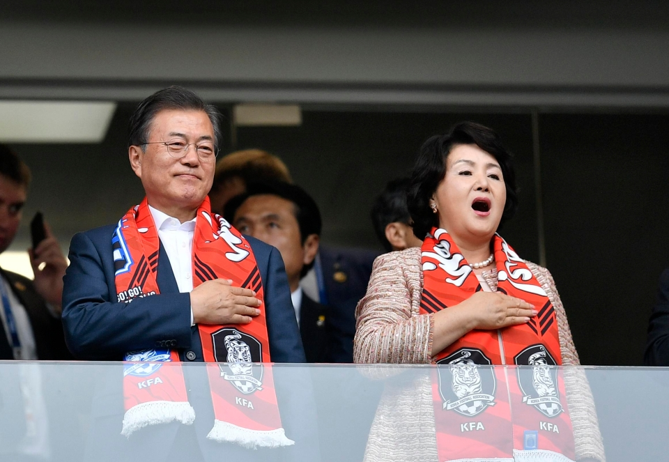 The South Korean President observed the national anthem before kick-off