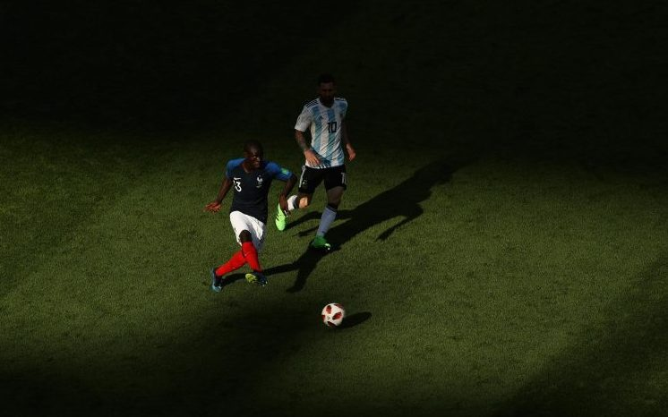 If only there was a photo that could aptly convey Kante putting Messi in his shadow
