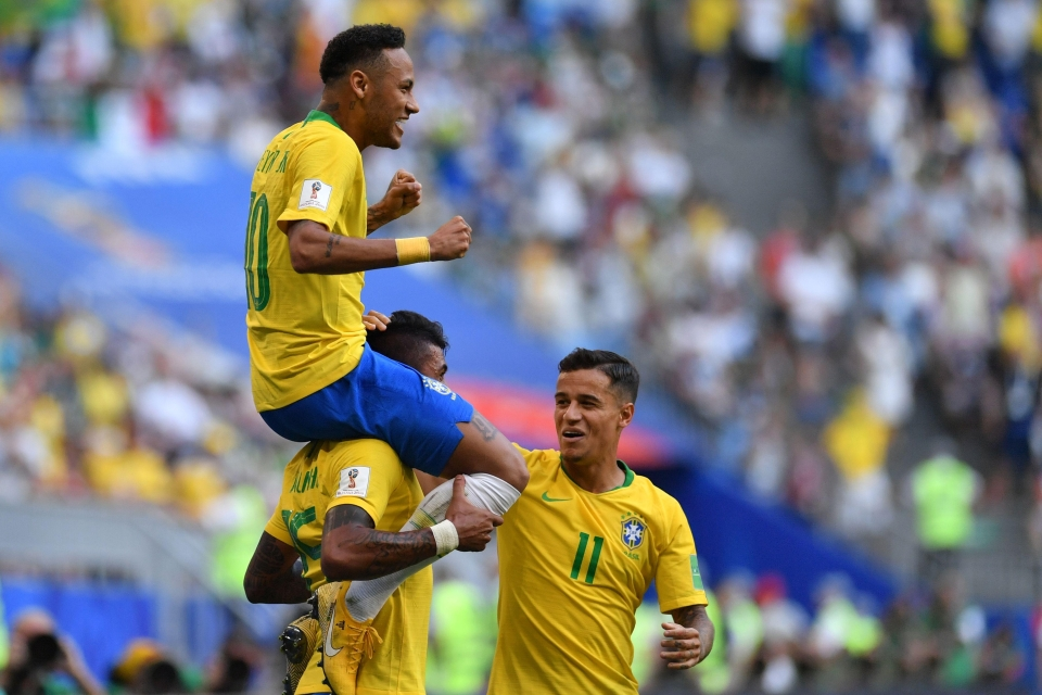 Neymar is held aloft after his opener against Mexico