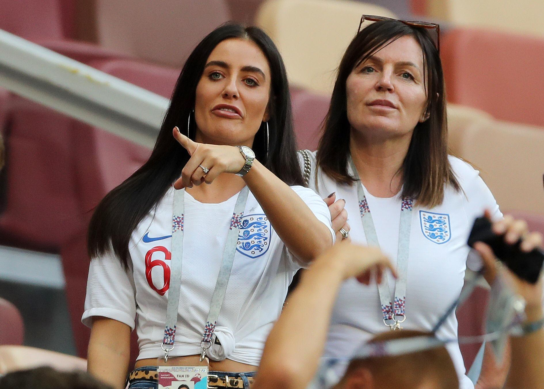 Fern points out her Harry Maguire as he warms up on the pitch in Moscow