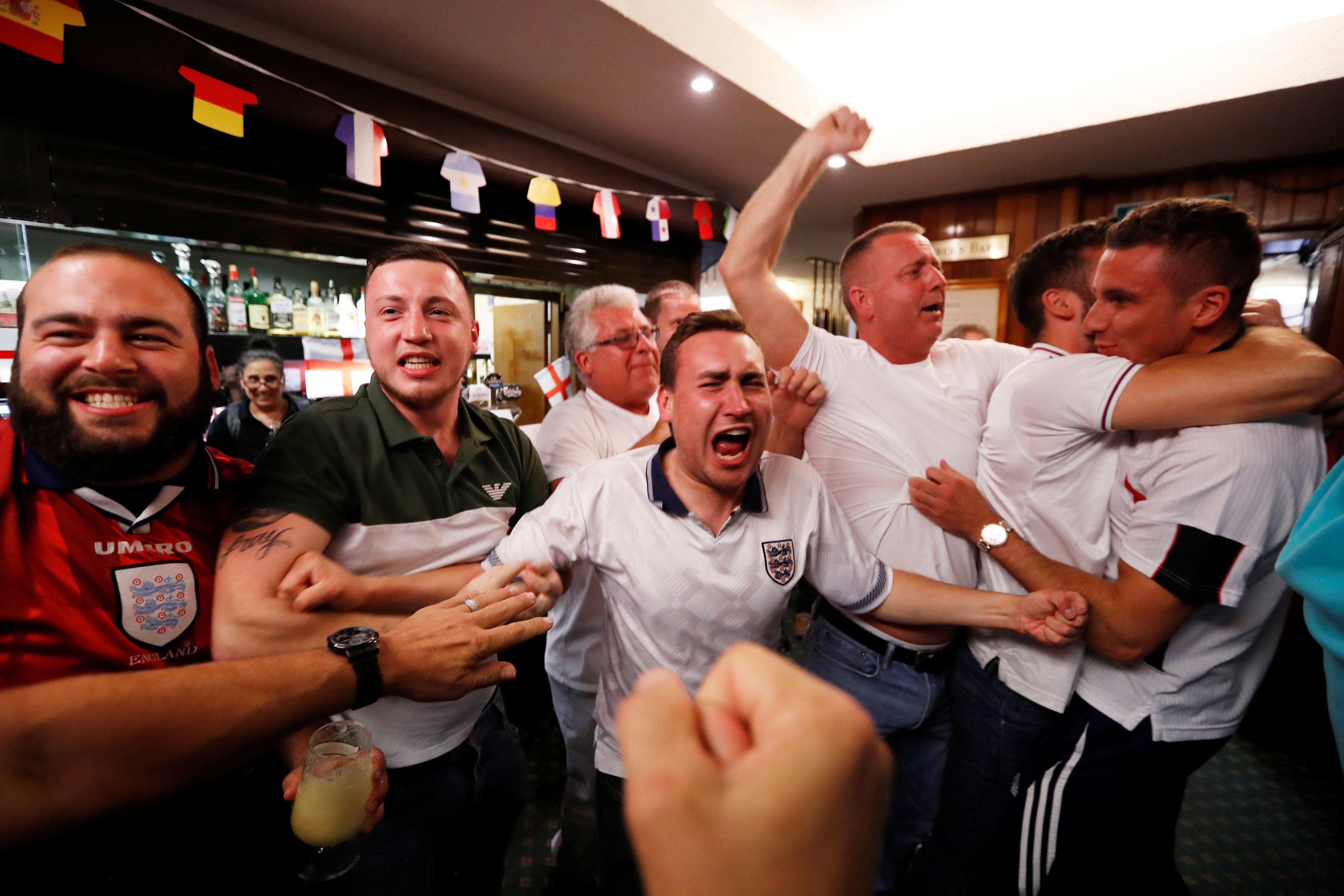 Fans at a pub in Southgate, London go bonkers as England take an early lead against Croatia