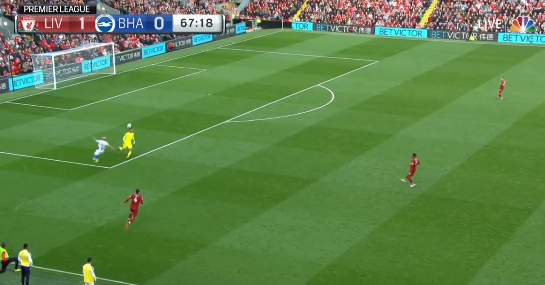 Alisson beats him to it and outrageously chips the ball over the top of him