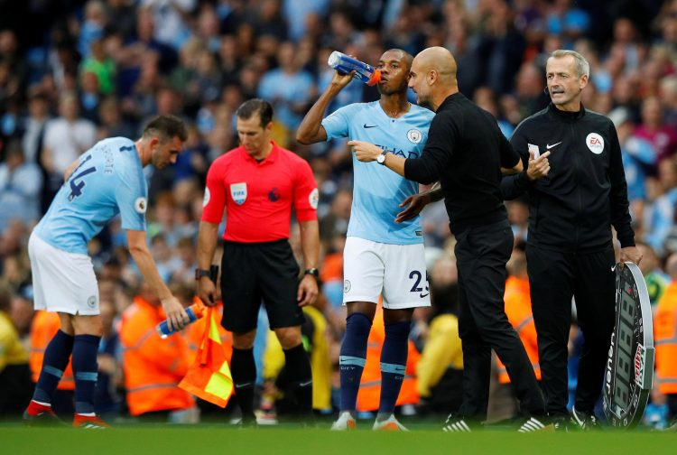 Pep checking that Fernandinho is tall enough to go on the roller coaster