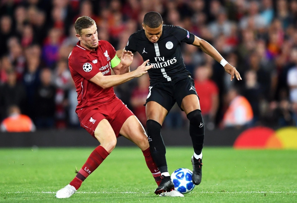 Henderson in action for Liverpool against PSG.