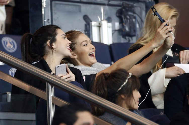 Kendall Jenner and Gigi Hadid taking selfies is football in 2018