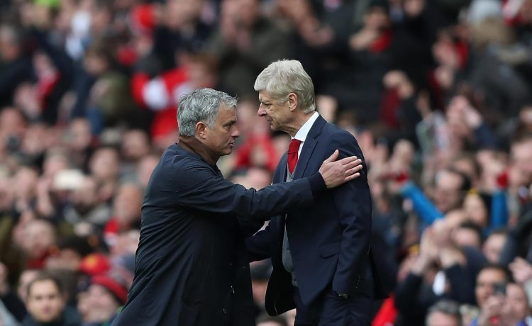 Wenger shaking the hand of the man he swindled