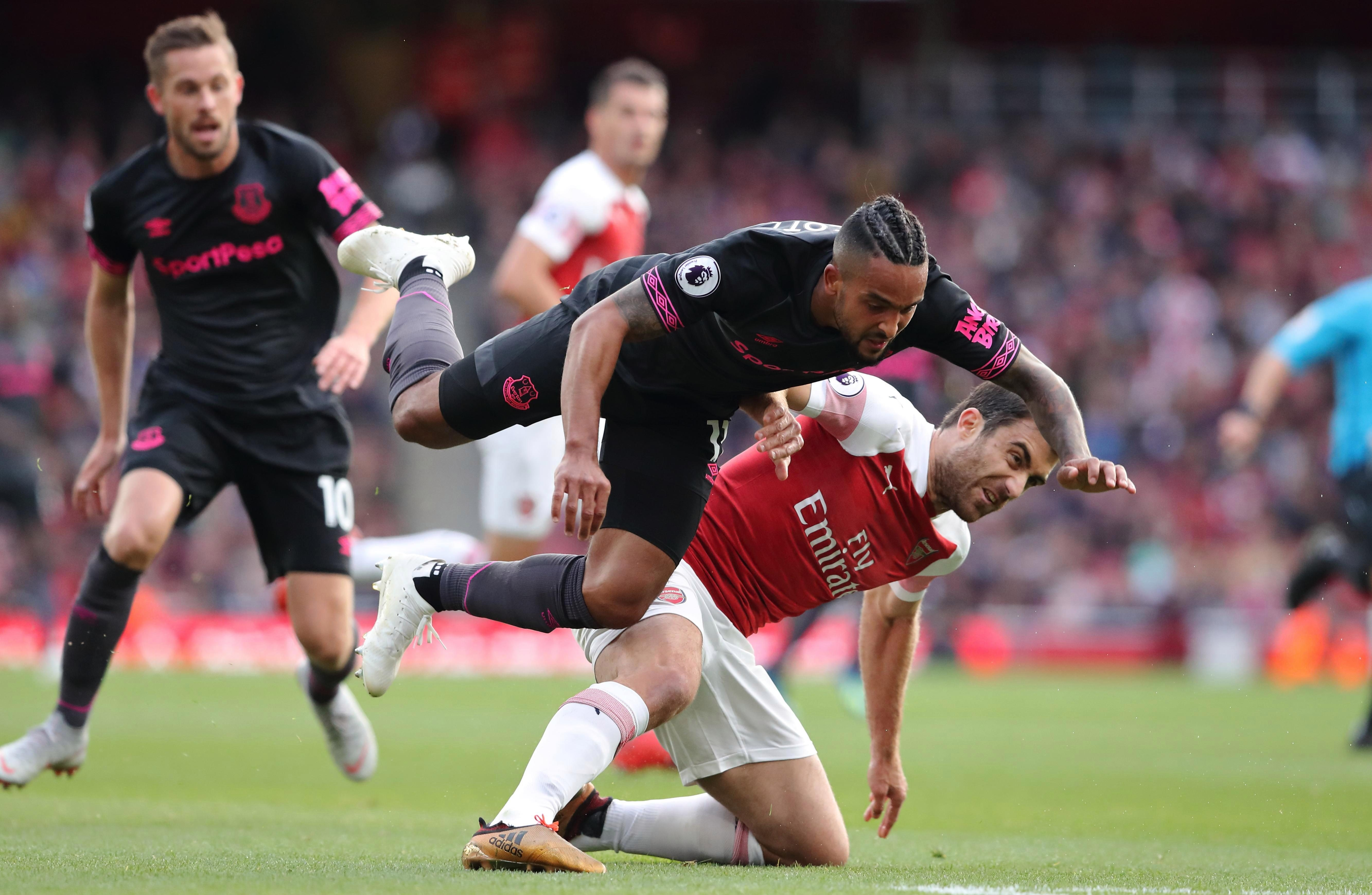 Crunching Theo Walcott. One way to endear yourself to the fans