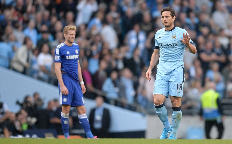 Lampard holds back from celebrating his goal against Chelsea