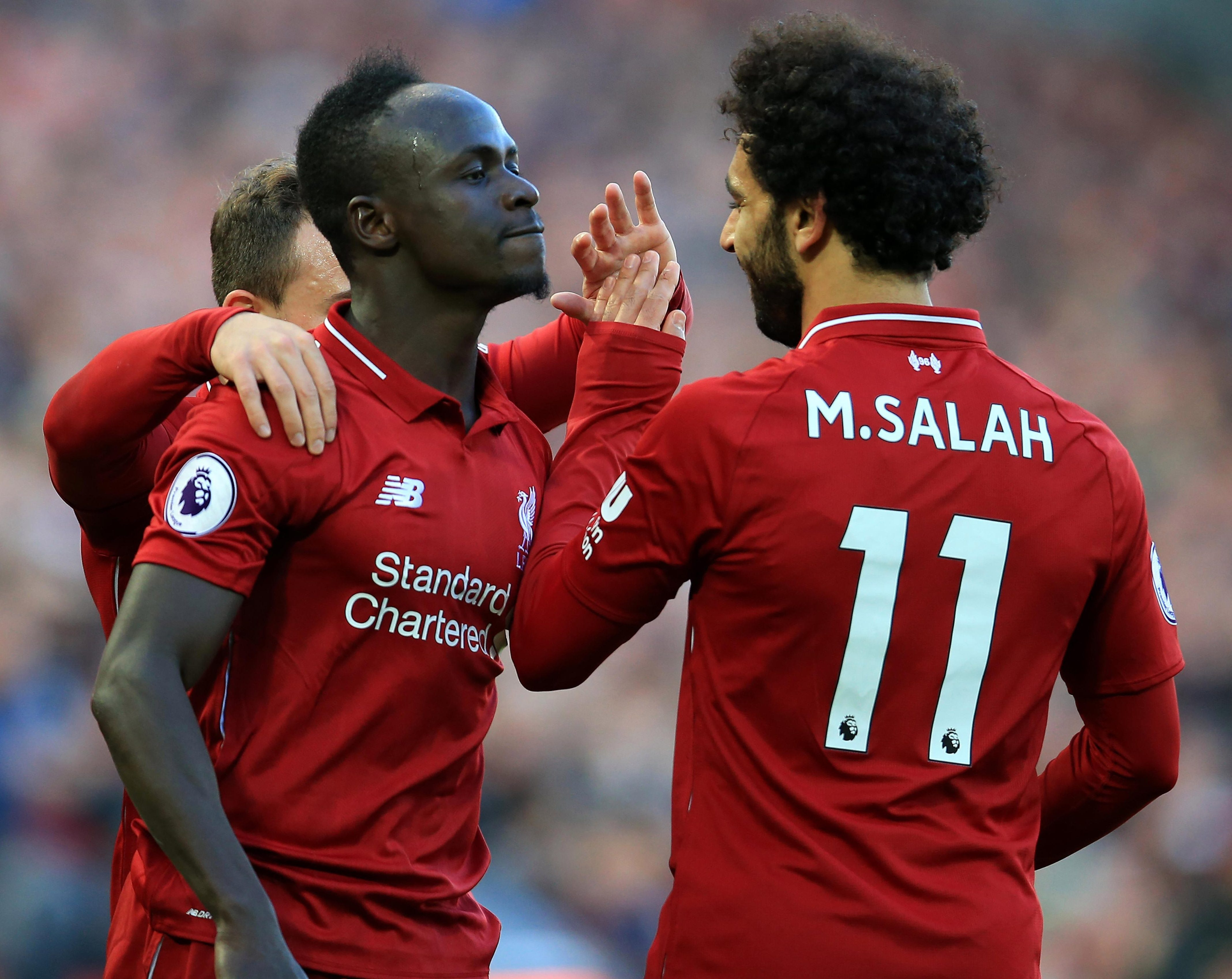 Liverpool are third with eight wins and three draws