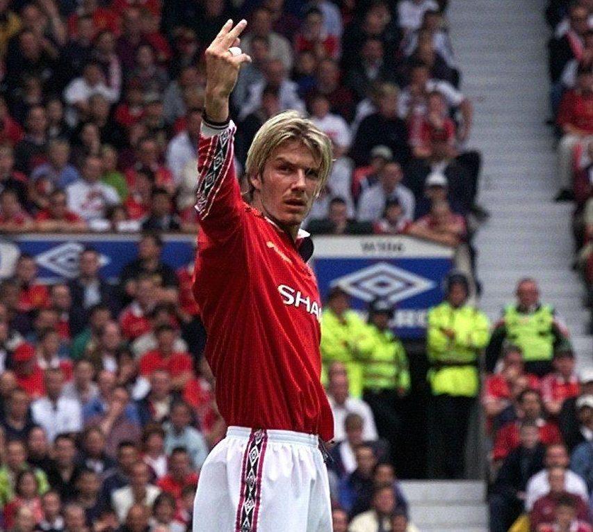 David Beckham gestures to the Leeds fans at Old Trafford
