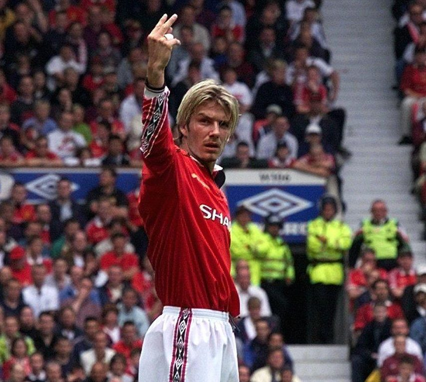David Beckham gestures to the Leeds fans at Old Trafford