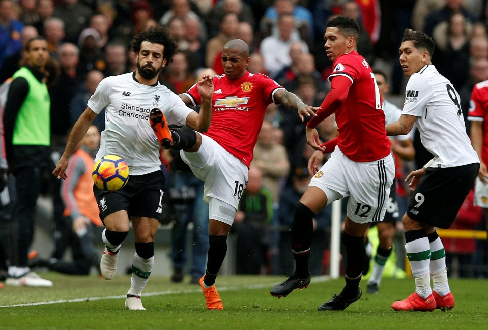 Young dealt with the threat of Salah at Old Trafford back in March