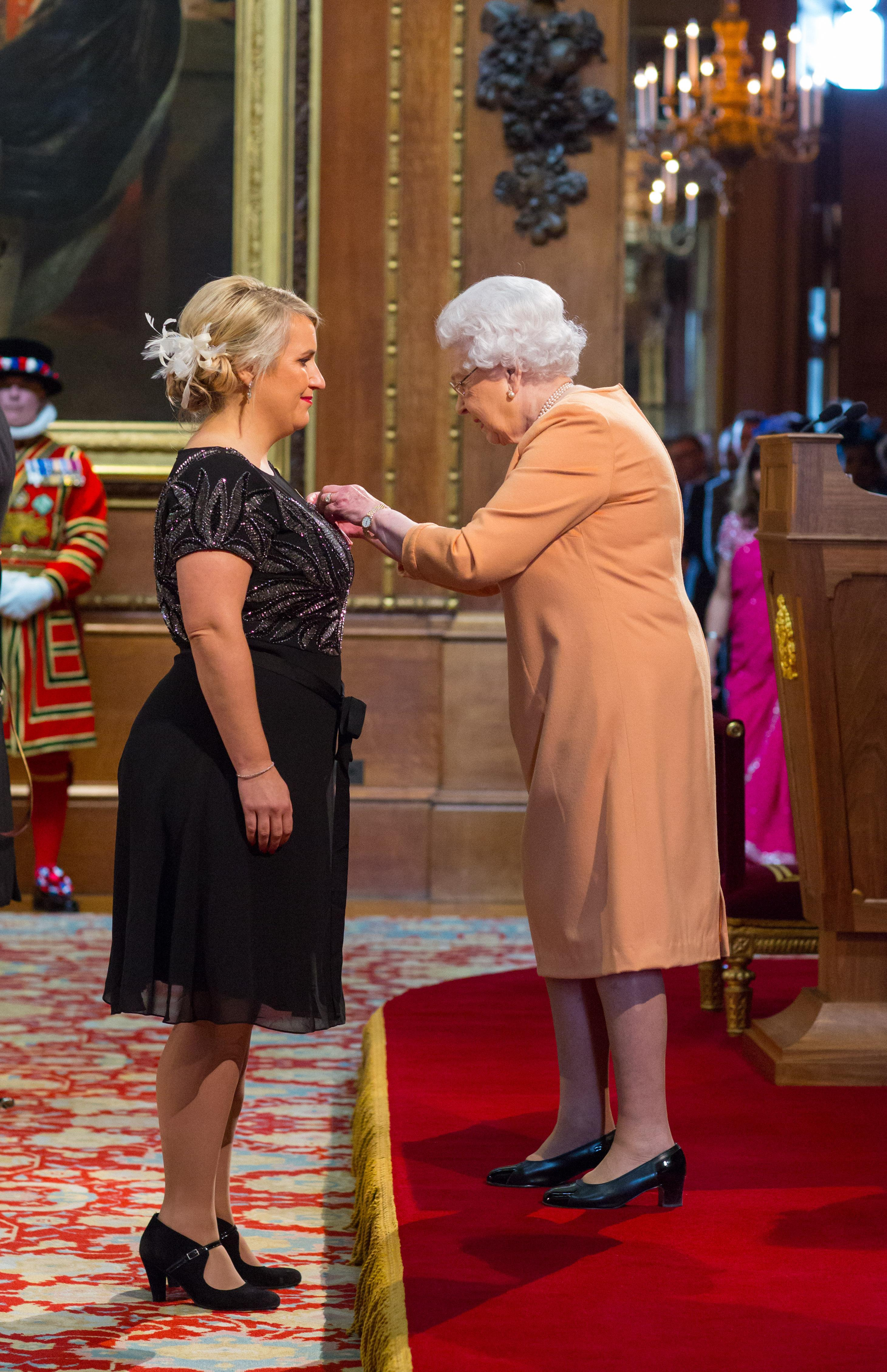 Hayes receiving an MBE from the Queen in 2016 for services to football