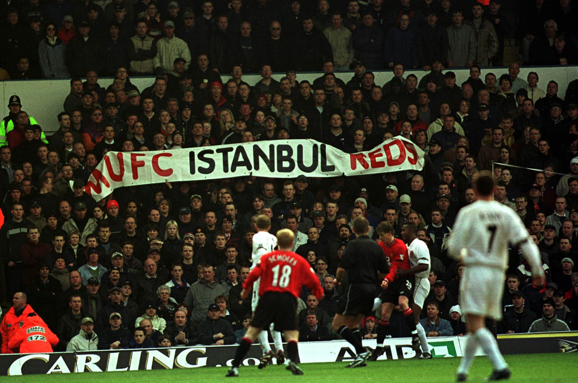 2001: Man United unfurl a banner in reference to the death of two Leeds fans