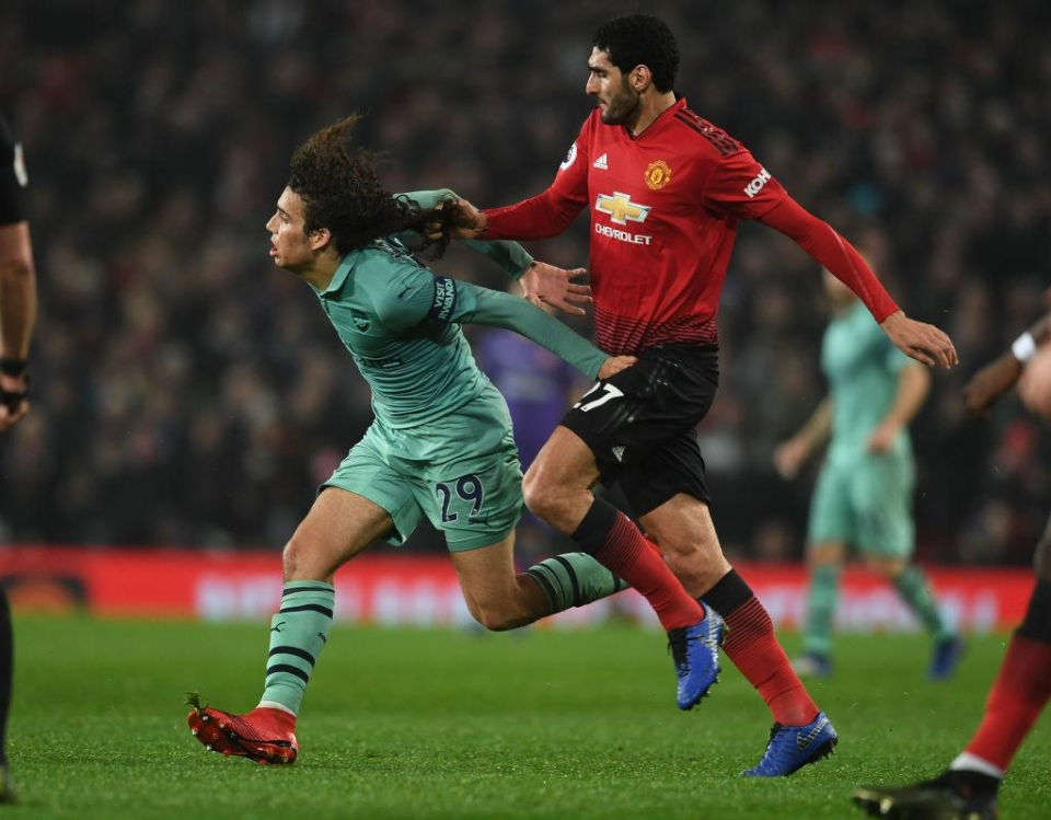 Marouane Fellaini of all people has hair envy