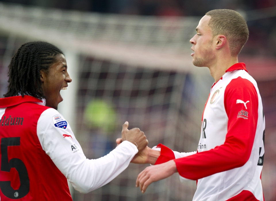 A young Castaignos saying goodbye to a long-haired Georginio Wijnaldum