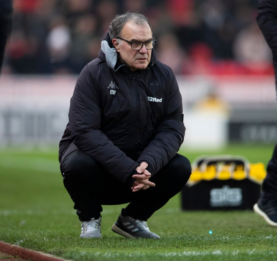 When he's not sitting on his blue 'bucket' Bielsa is often crouched on his haunches in silent contemplation