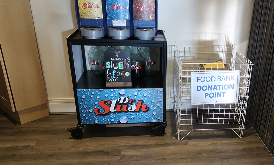 The local food bank collects donations in the club's Sandy Pate Sports Bar
