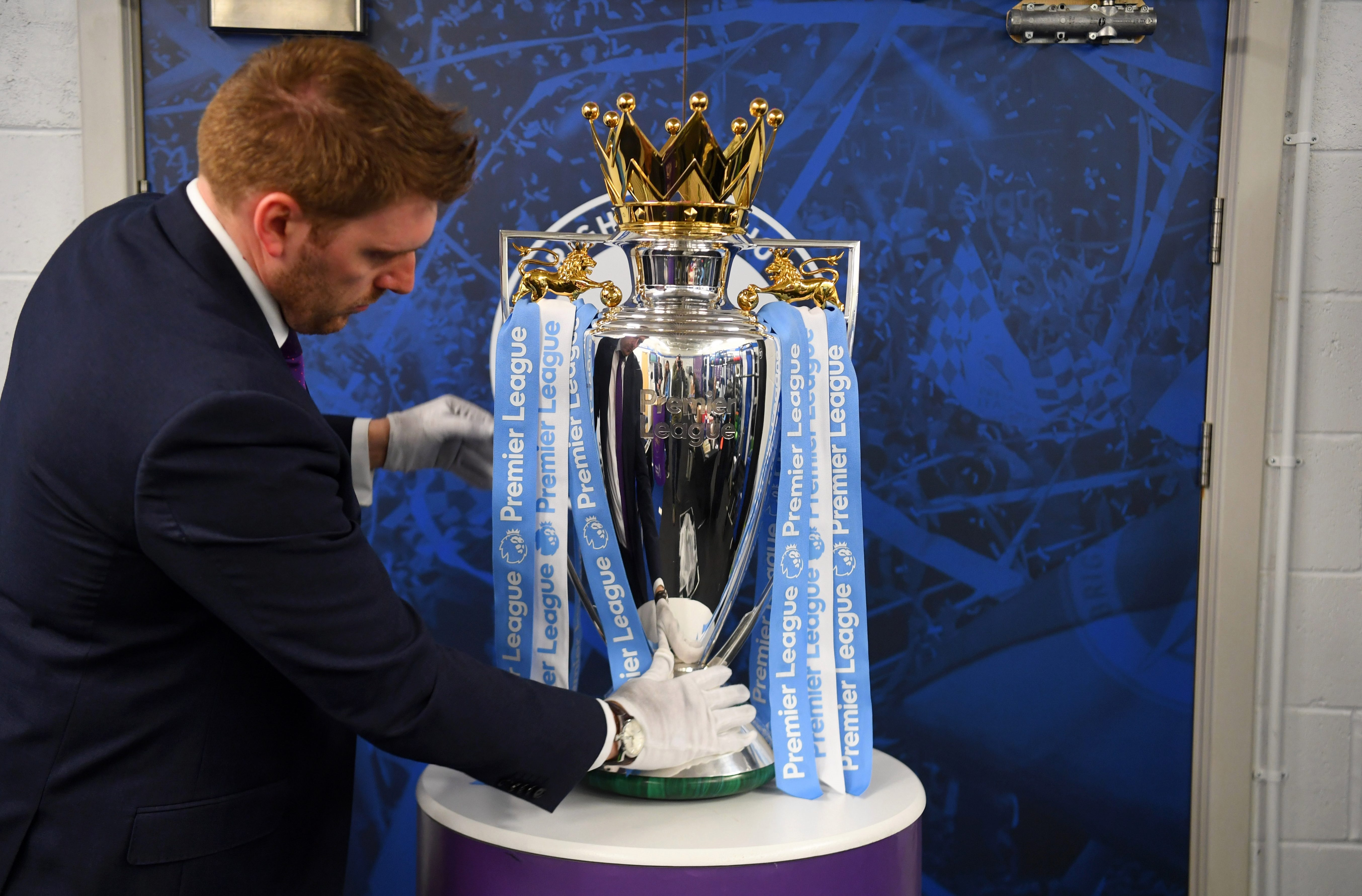 The blue ribbons on the trophy