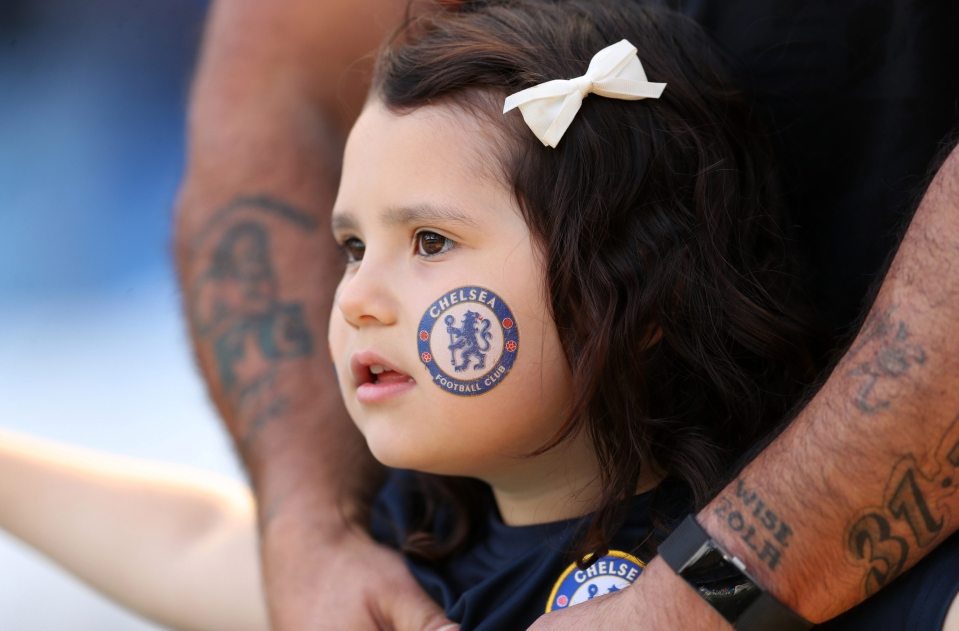 A young fan watches on