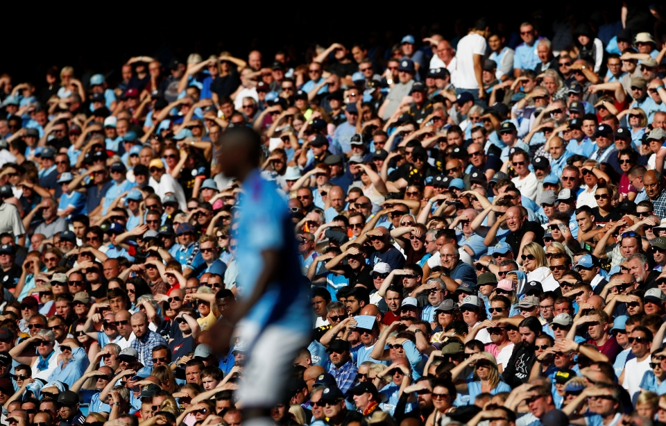 City fans shield their eyes from the sun as they enjoy an 8-0 exhibition