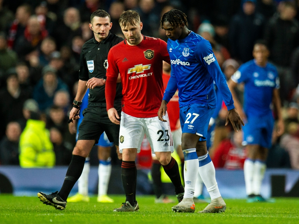 Luke Shaw ushered off the dejected forward