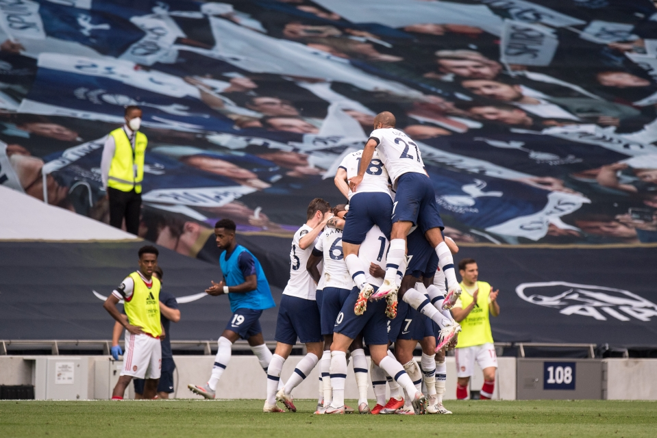 Spurs players celebrate the winning goal yesterday