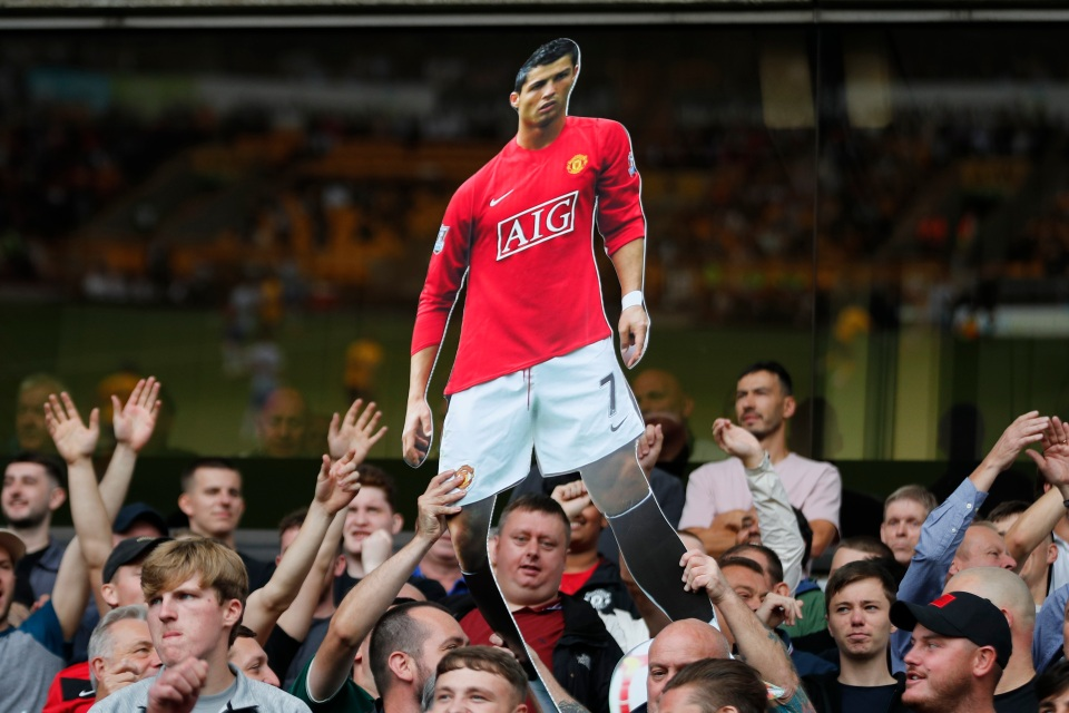 Man United fans held a cutout of Ronaldo aloft in the away end at Molineux at the weekend